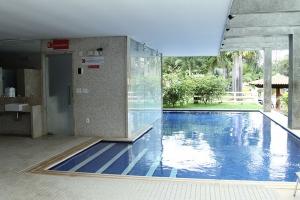 Ideia 01 - Piscina em alvenaria com sauna a vapor separada em ambiente semi aberto.